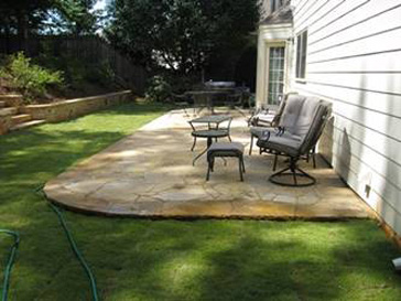 This Is A Stamped Concrete Patio And Walkway With A Small Sitting Flagstone  Wall.
